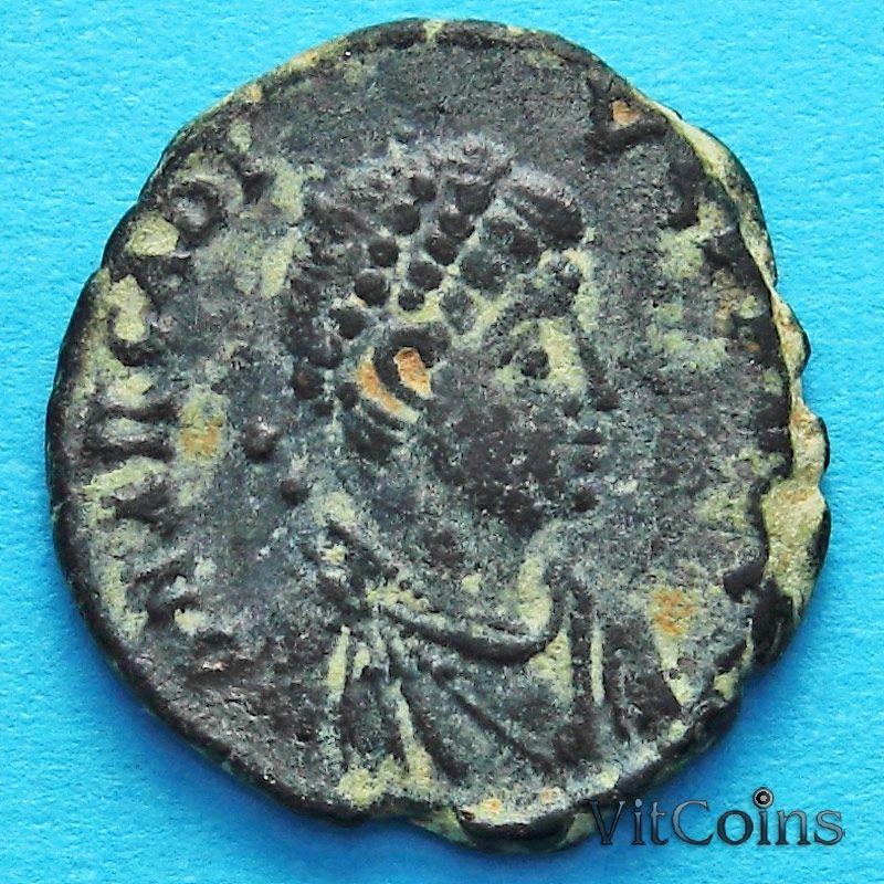 Монета Римская империя, фоллис Аркадий 395-401 год.