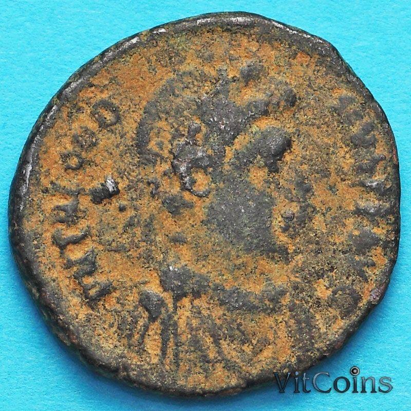 Монета Римская империя, фоллис Феодосий I 392-394 год. Константинополь. №2