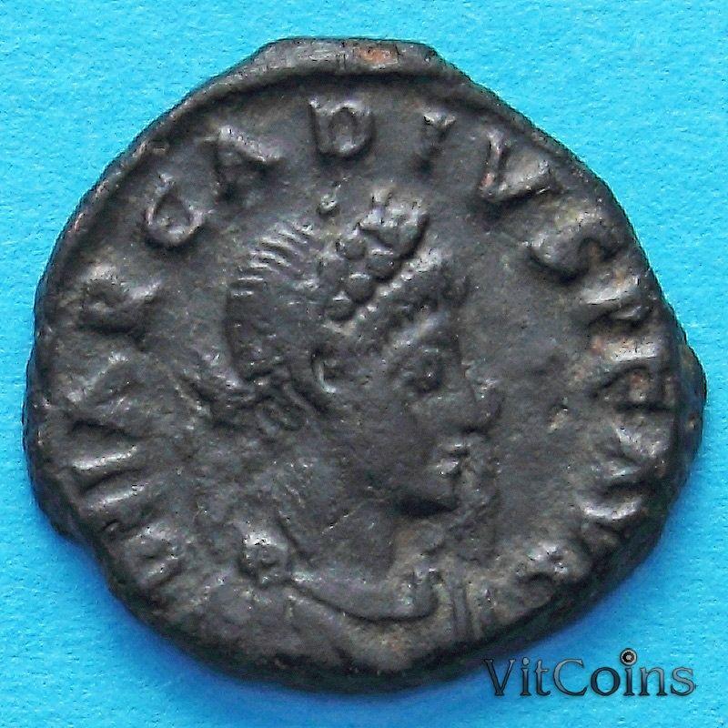 Монета Римская империя, фолис Аркадий 383 год.