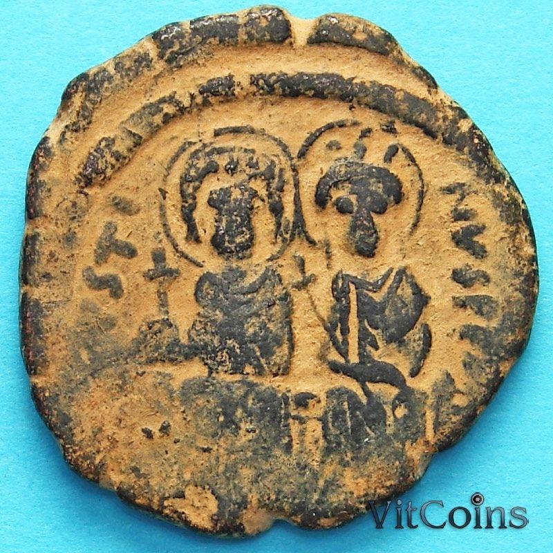 Монета Византия фоллис Юстин II 565-578 год. Юстин и София.